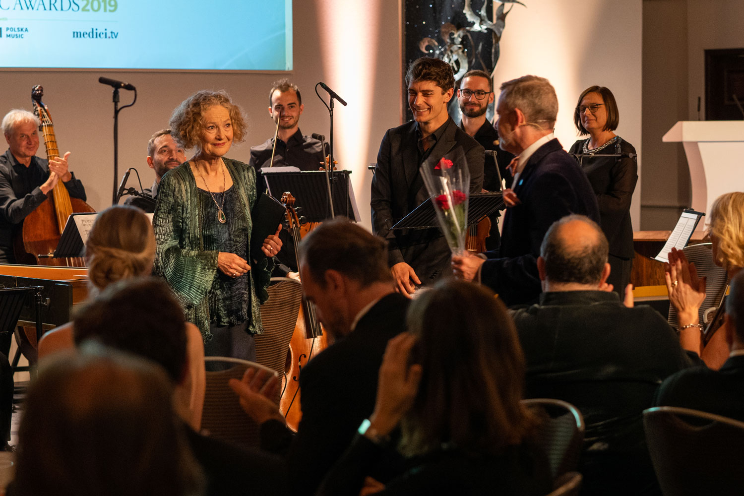 Young Artist Jakub Józef Orlinski and Lifetime Achievement Award-winner Dame Emma Kirkby, who receives a rose from James Jolly
